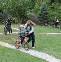 Kids Riding on Bike Trail at Lakeshore Park