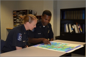 Two police offiers looking at map