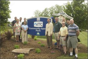 Mayor Landry along with many people standing in front of new ITC Community Sports Park sign